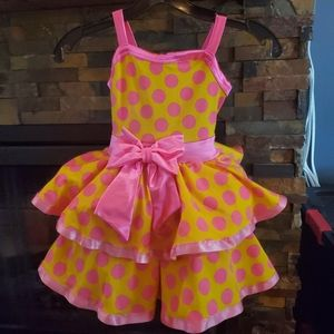 Yellow and pink polka-dot dance costume